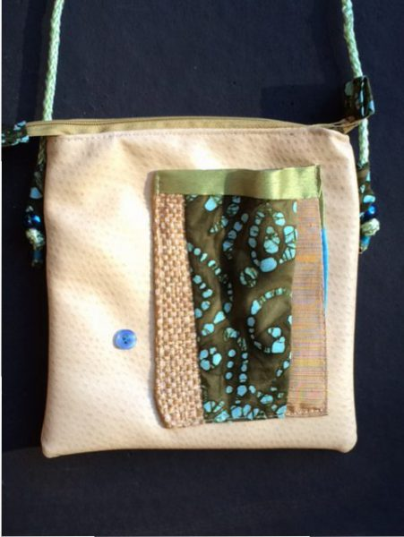 Tibetan Style Passport Bag front - green,aqua, batik, textured vinyl
