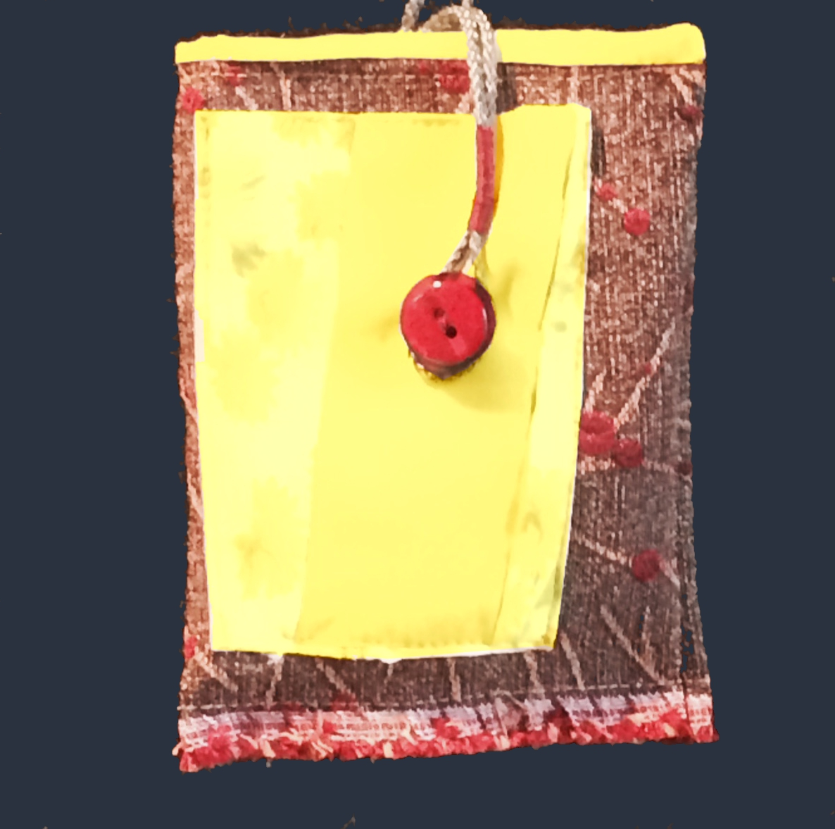 Dual red button closure and bright yellow lining compliment this branch and cherry fabric.