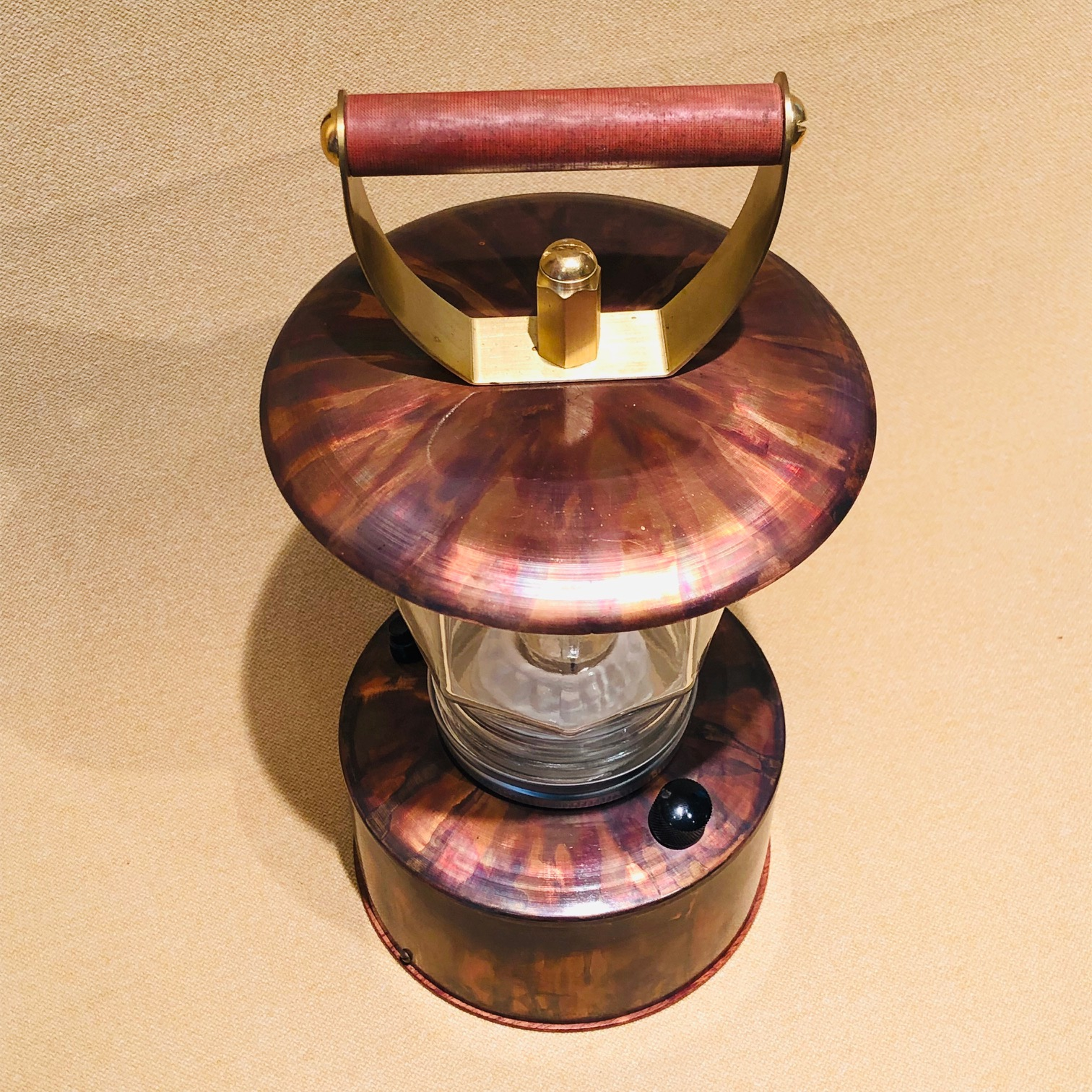 portable bug-out LED lantern in copper, glass and phenolic