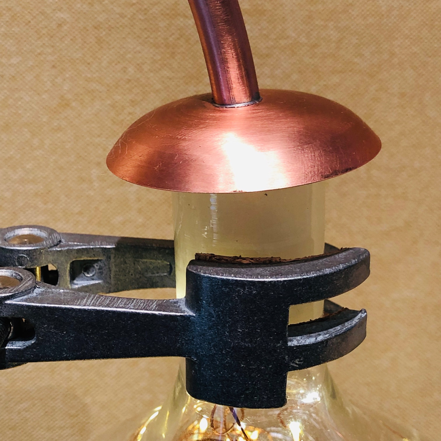 lamp detail showing copper, glass and iron