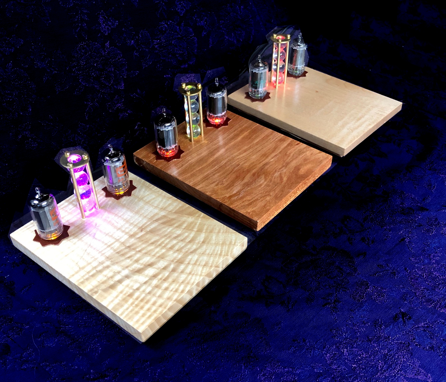 picture of 3 wireless cell phone chargers made with local Appalachian wood surfaces and led lights