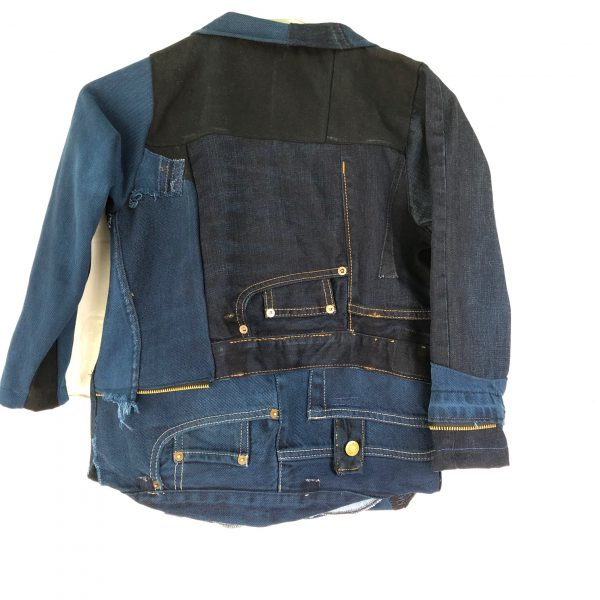 the back of this childs denim coat features topstitching, pocket details, rivets and everything that makes jeans.