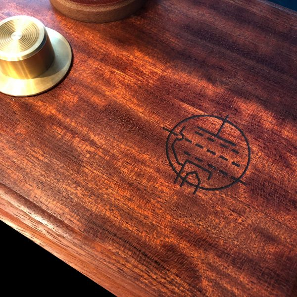 engraved detail shows a circuit schematic of a wireless charger. this lamp has 2 wireless chargers in the base