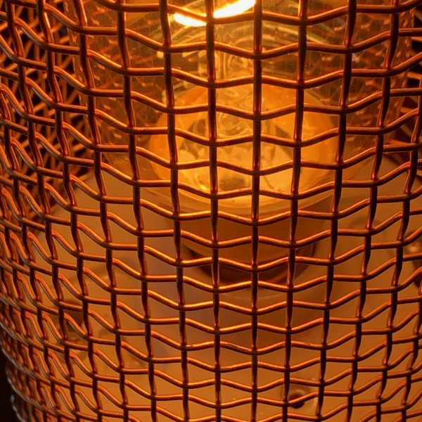 amber glow through the copper mesh